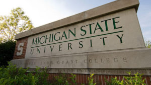 A sign with the words Michigan State University.