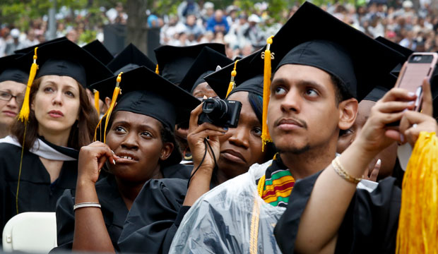 Graduating students listen to a commencement speech on June 3, 2016, in New York.