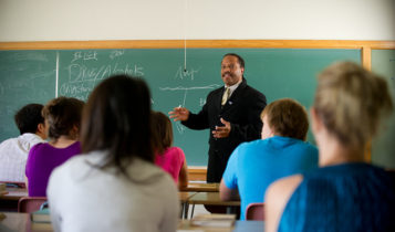 Professor teaching in a classroom.