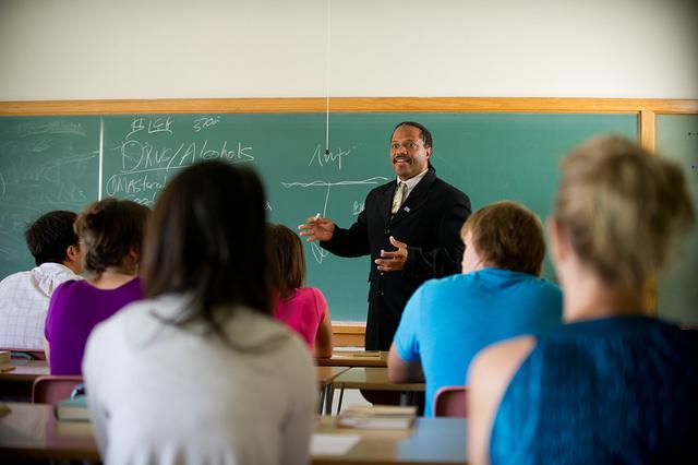 Professor teaching in a classroom.
