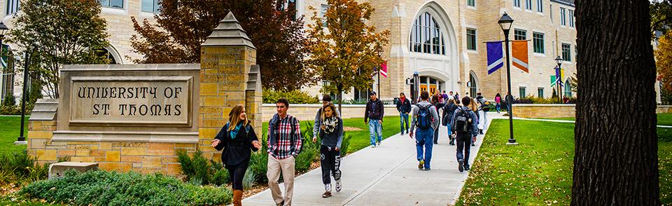 Students walking on the University of St. Thomas campus.