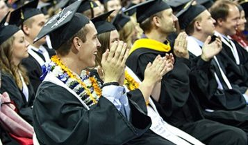 Students during a graduation ceremony at Utah State University.