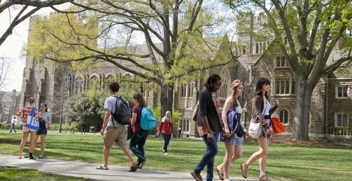 Students walking across the Duke University campus.