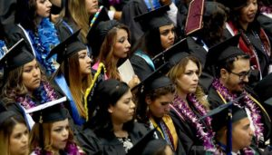 A group of Hispanic students at a graduation ceremony.
