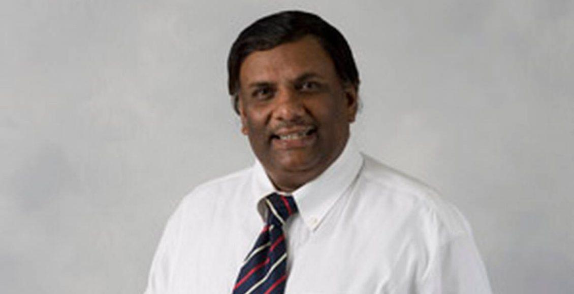 A headshot of Ashim Mitra.