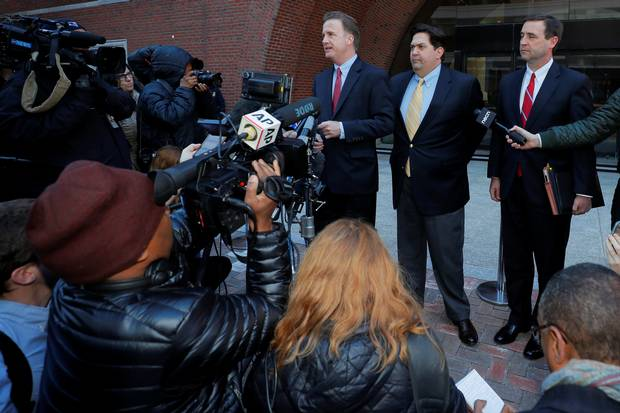William Ferguson, former women's volleyball coach at Wake Forest University facing charges in a nationwide college admissions cheating scheme, and his lawyers talk to reporters as they arrive at the federal courthouse in Boston, Massachusetts, U.S., March 25, 2019.