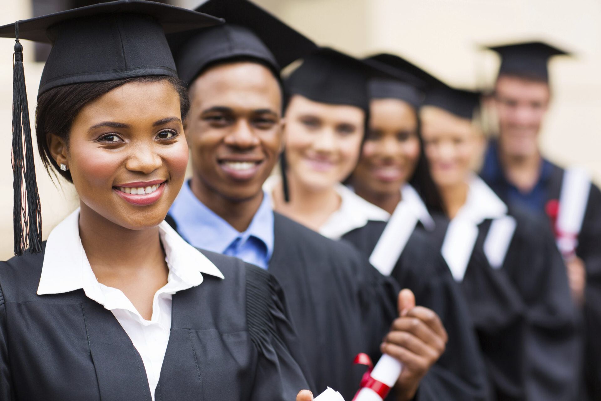 A group of students receiving college degrees.
