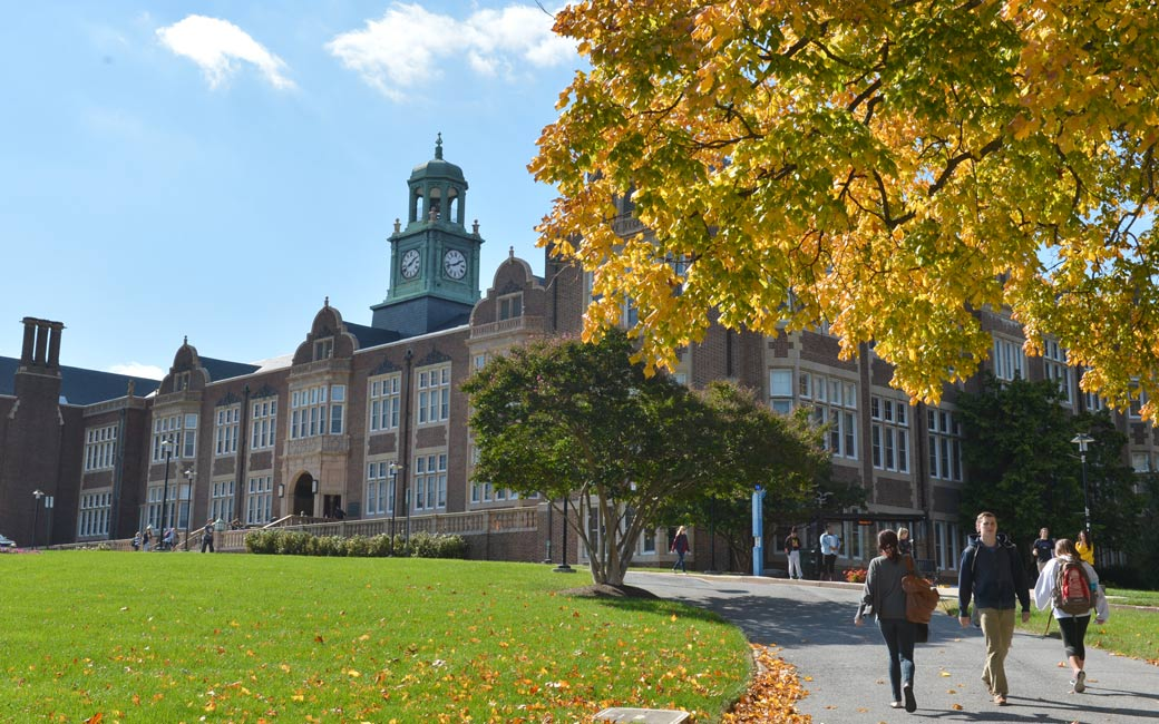 Students walking across the Towson University campus.