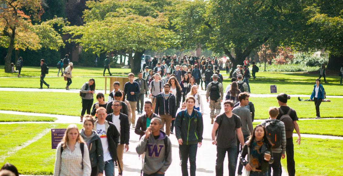 Students walking across the University of Washington campus.