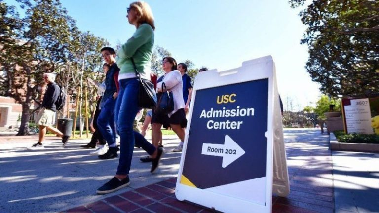 Adults and prospective students tour the University of South California in Los Angeles.