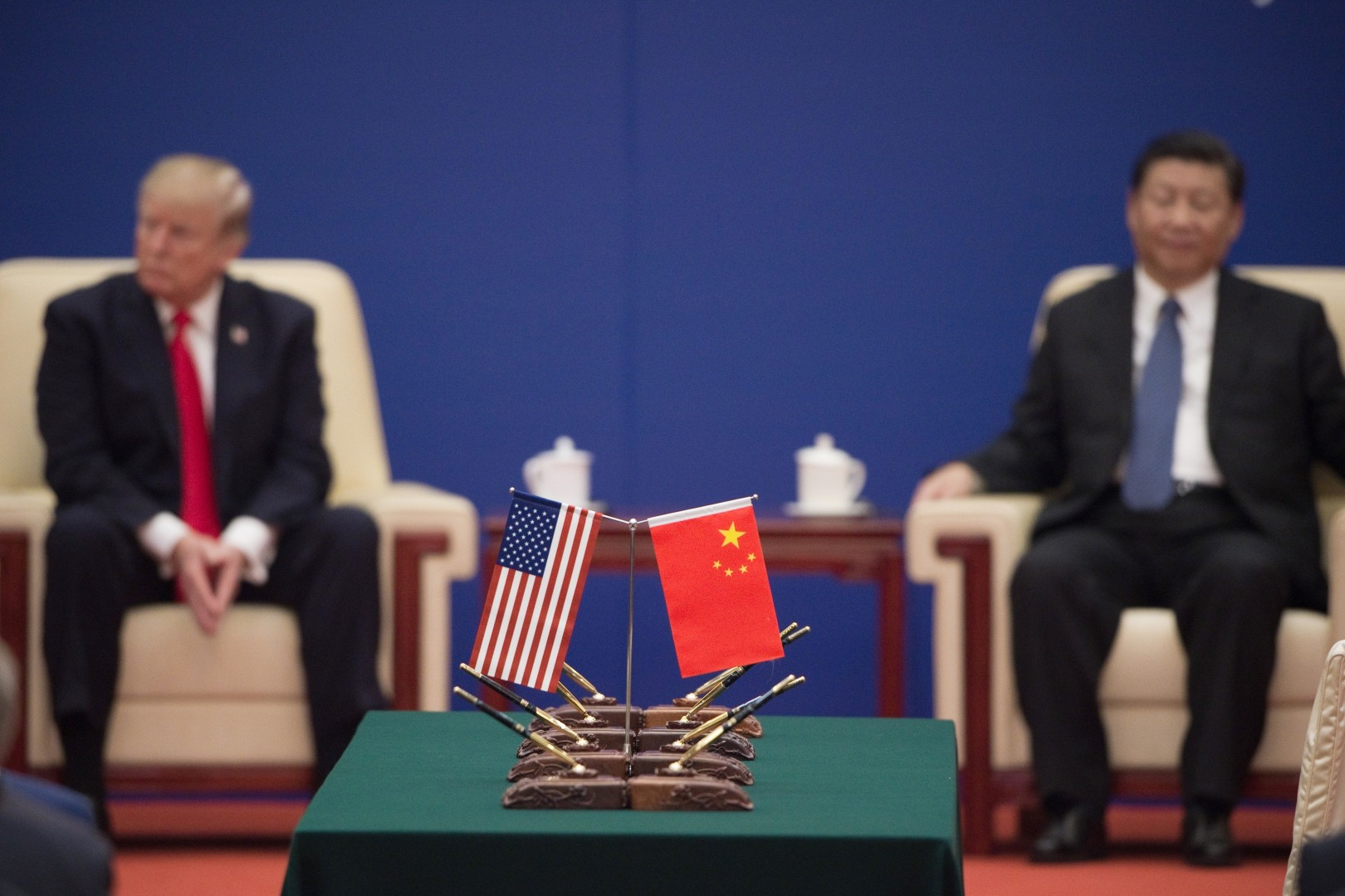 President of the United States Donald Trump and President of China, Xi Jinping attend a meeting of business leaders.