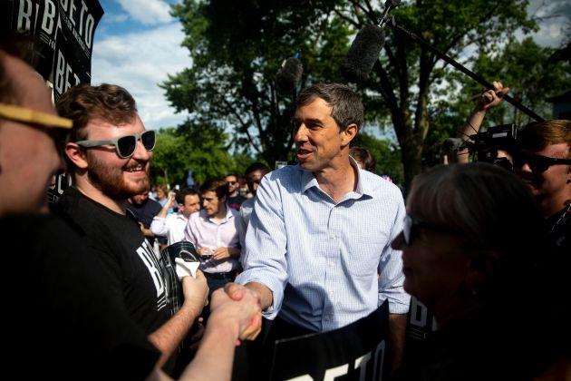 Sen. Beto O'Rourke shaking hands in a crowd of people.
