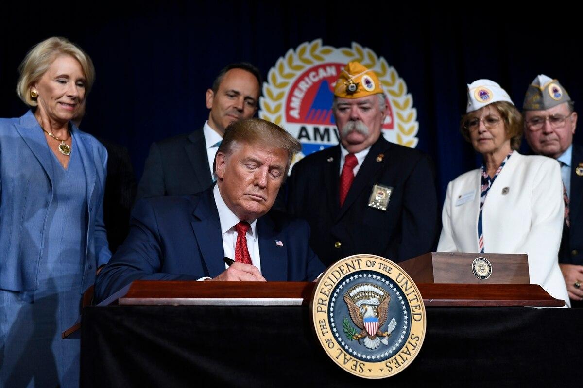 President Donald Trump signs a memorandum