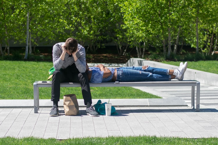 Two students on a bench, mental health