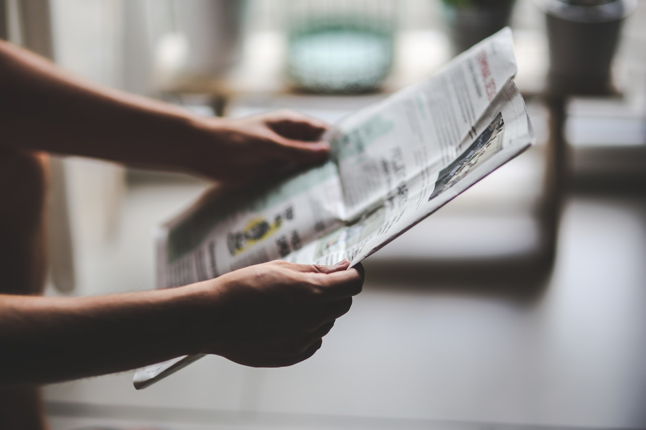 Photo of someone holding a newspaper