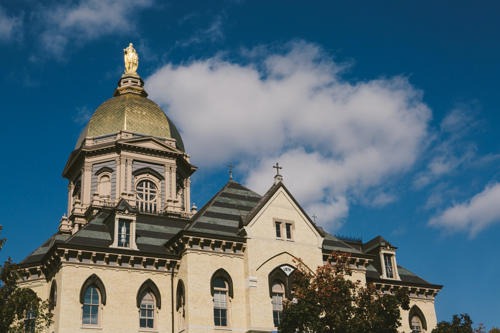 Mid shot of the Statue of Mary and the Golden Dome on top of Notre Dame University Administration Building