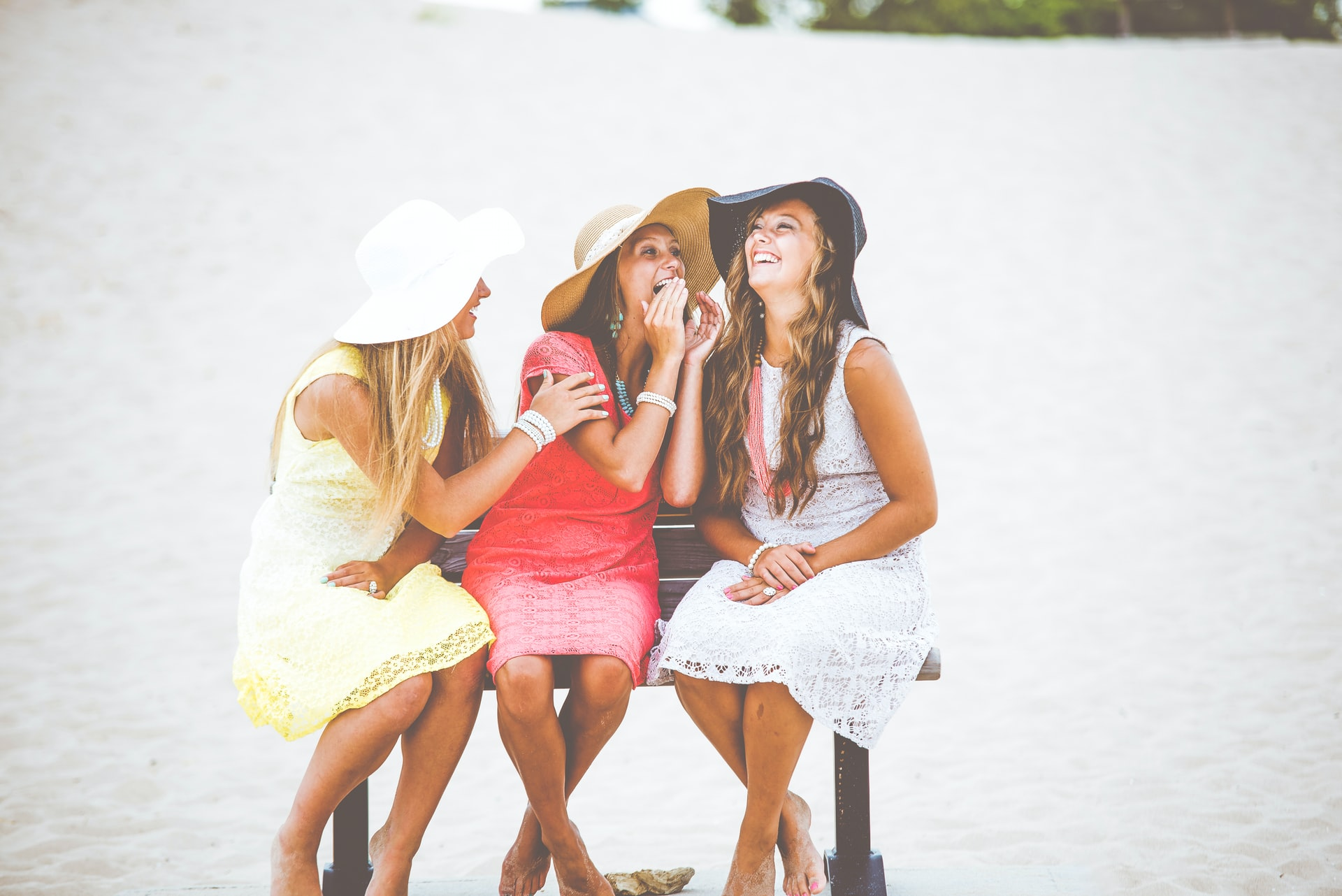 Photo of three women chatting on a bench.