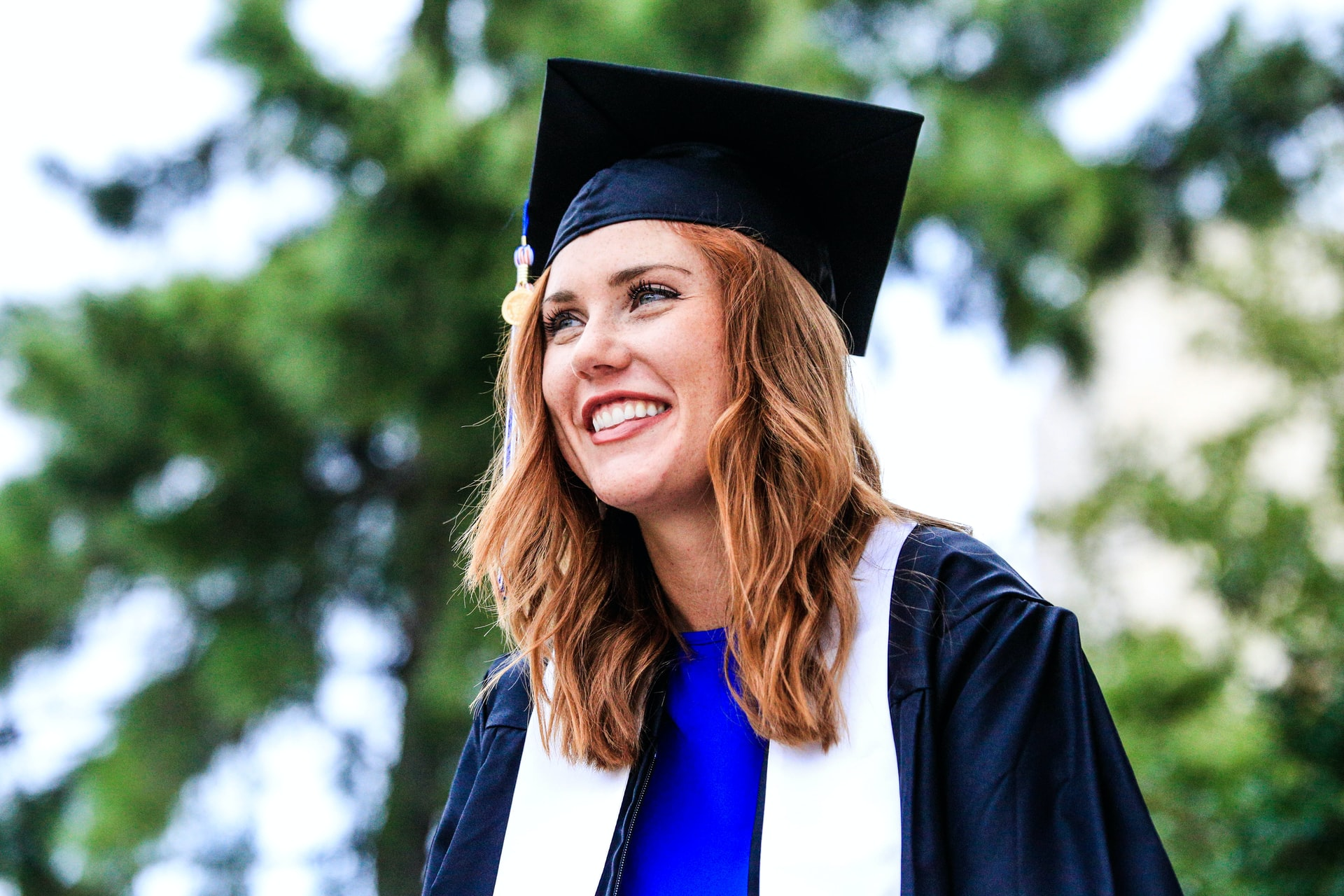 photo-of-happy-graduating-student-from-cheap-college-in-the-us