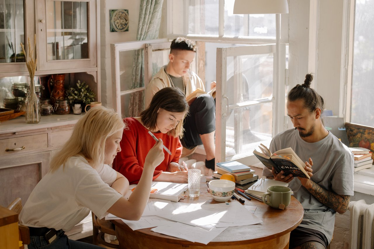 photo-of-group-of-students-studying-at-table-for-finals