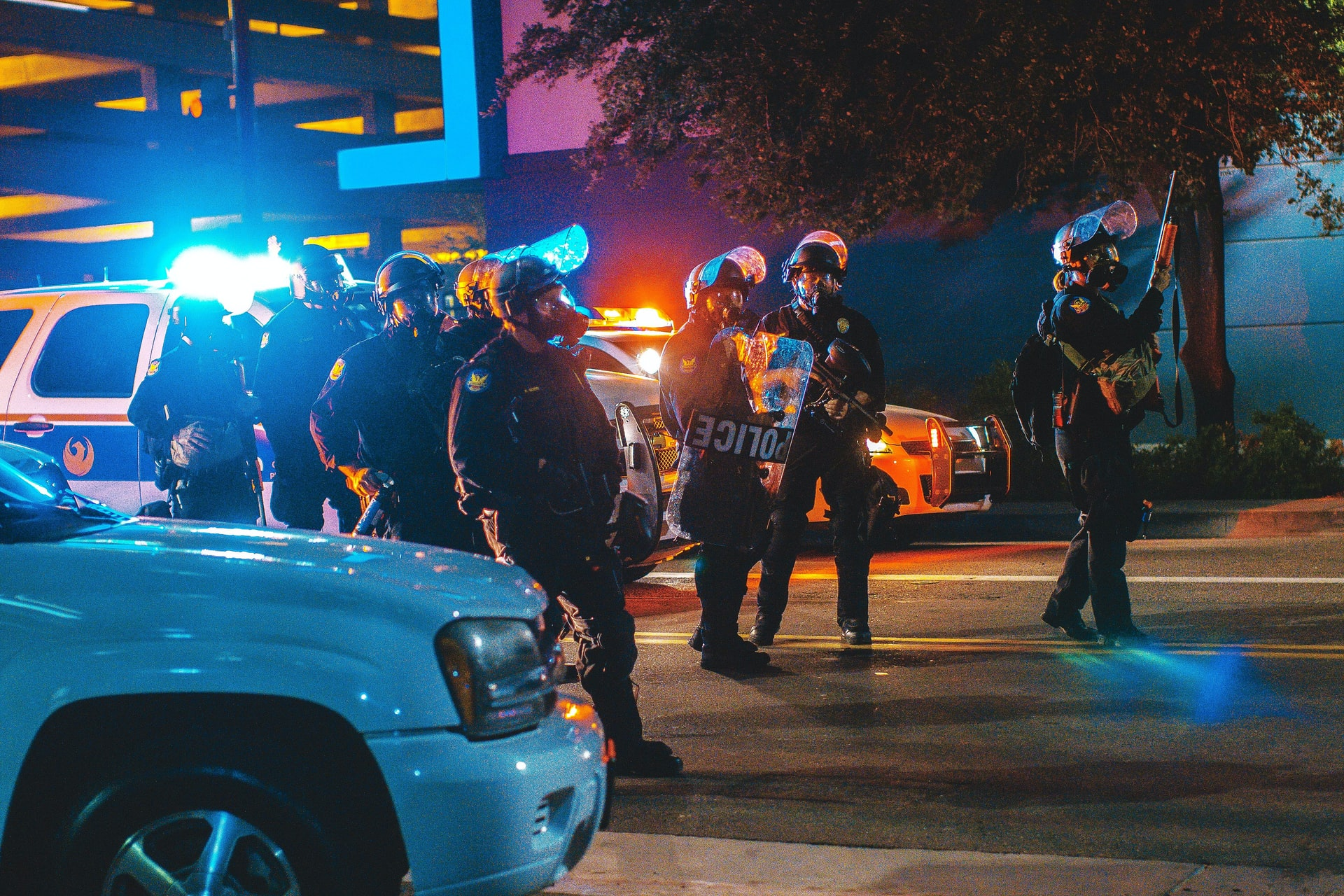 photo-of-riot-police-and-car-at-night-people-know-their-rights-campus-police