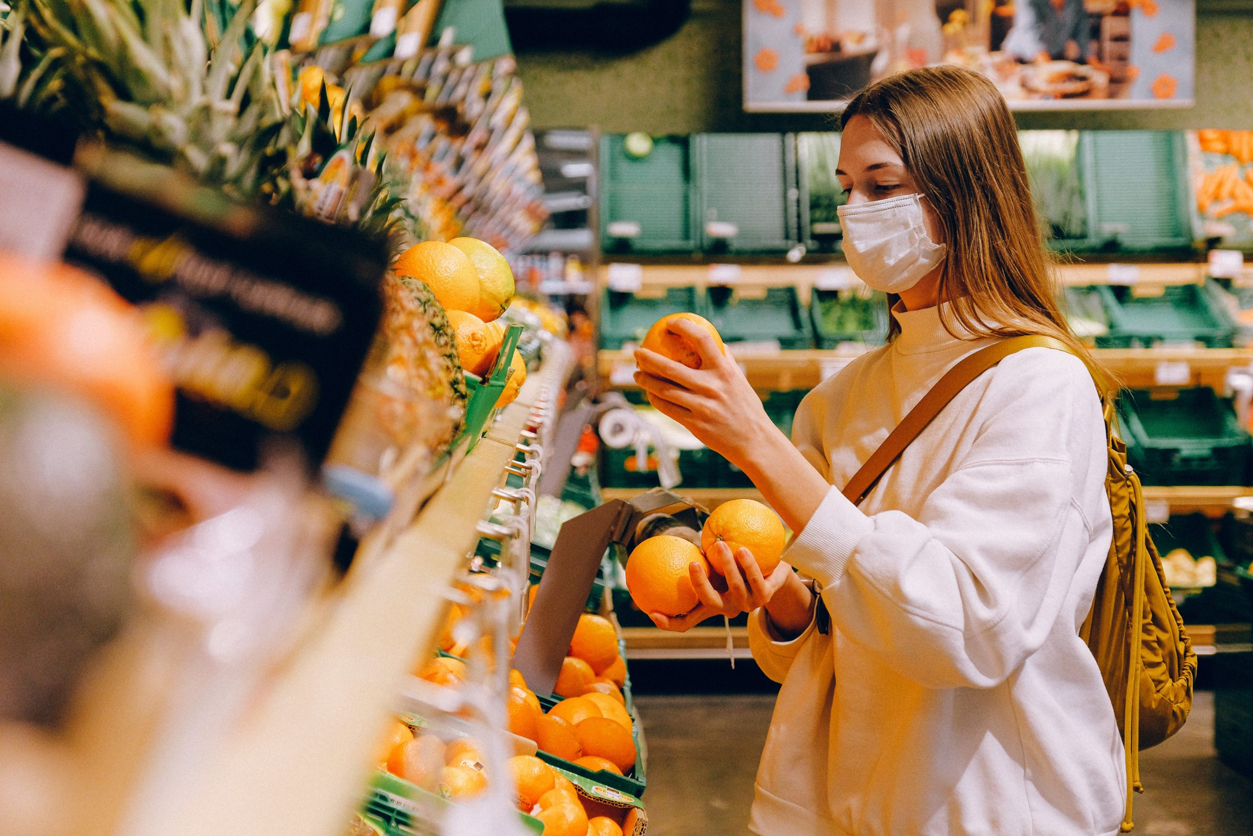 Photo of a female student buying fruits