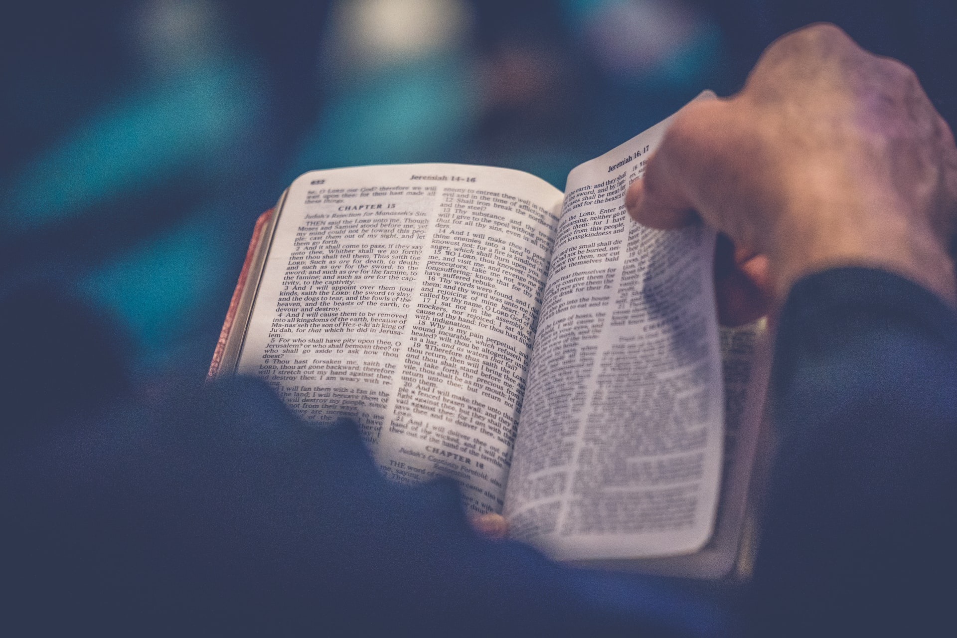 Photo of someone reading the bible.