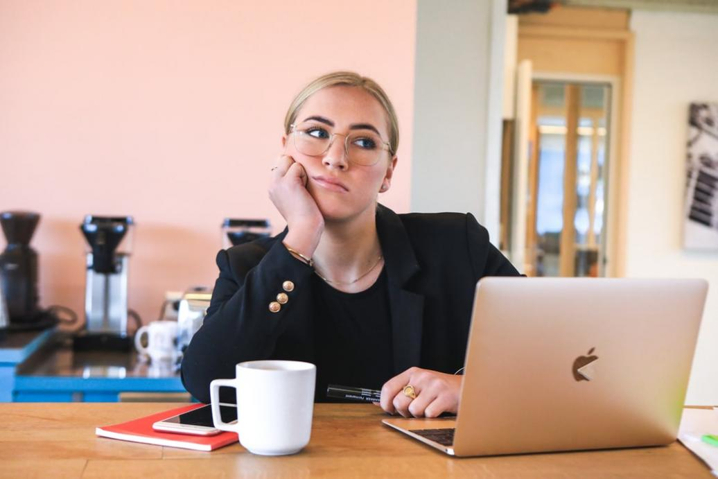 Photo of a woman sitting in front of her laptop