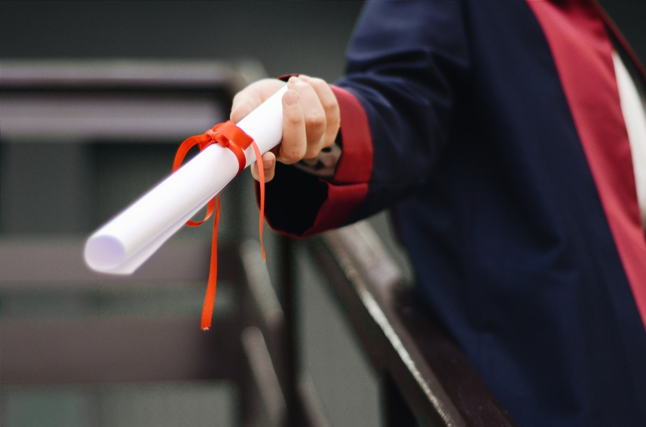 Photo of someone holding a diploma