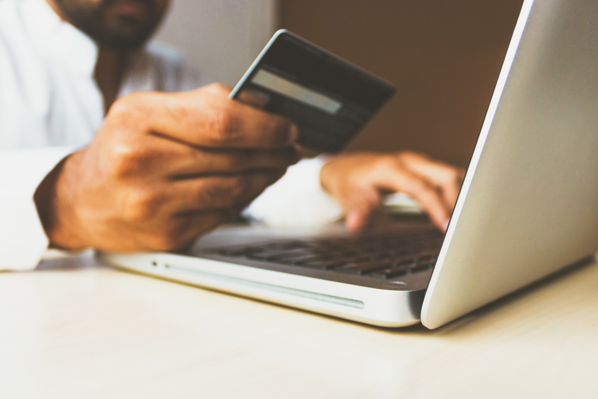 man using credit card to pay for an online transaction