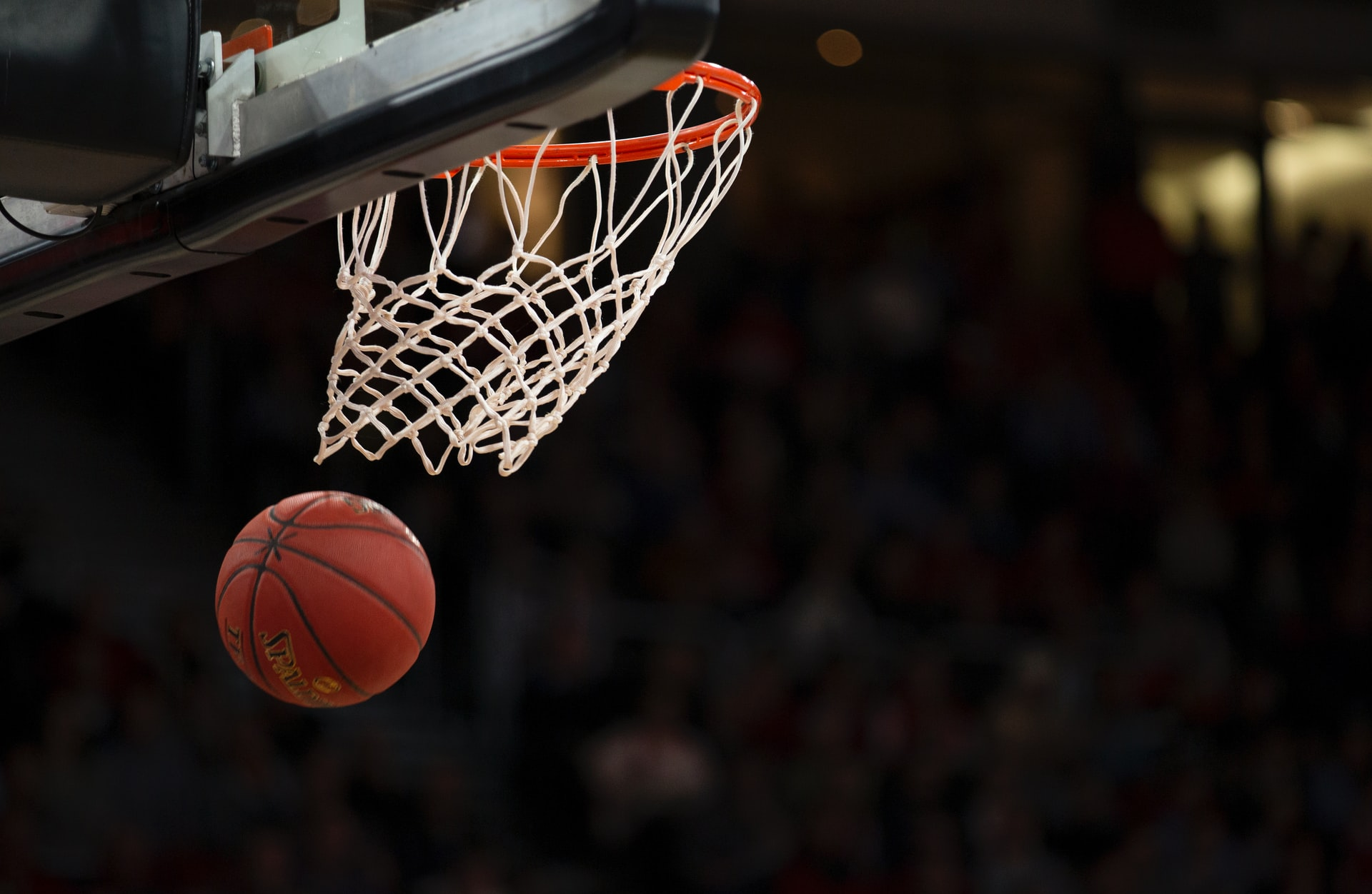 Photo of a basketball going through a hoop