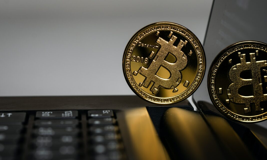 Bitcoin cryptocurrency on a laptop.