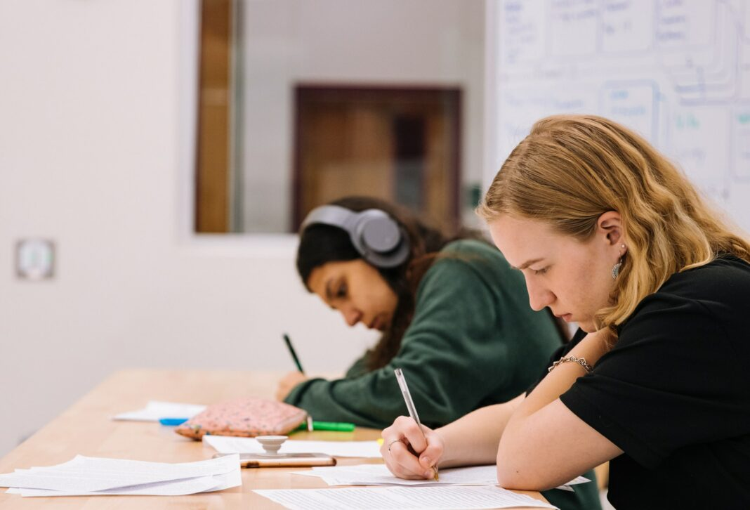 Photo of two students taking a test in a classroom