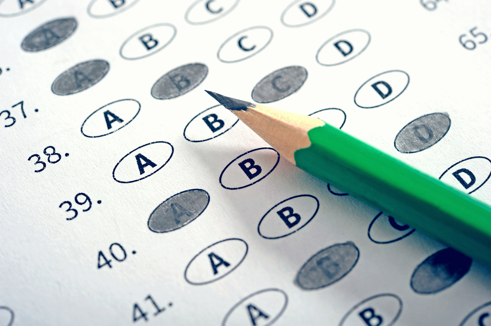 College exam answer sheet with pencil