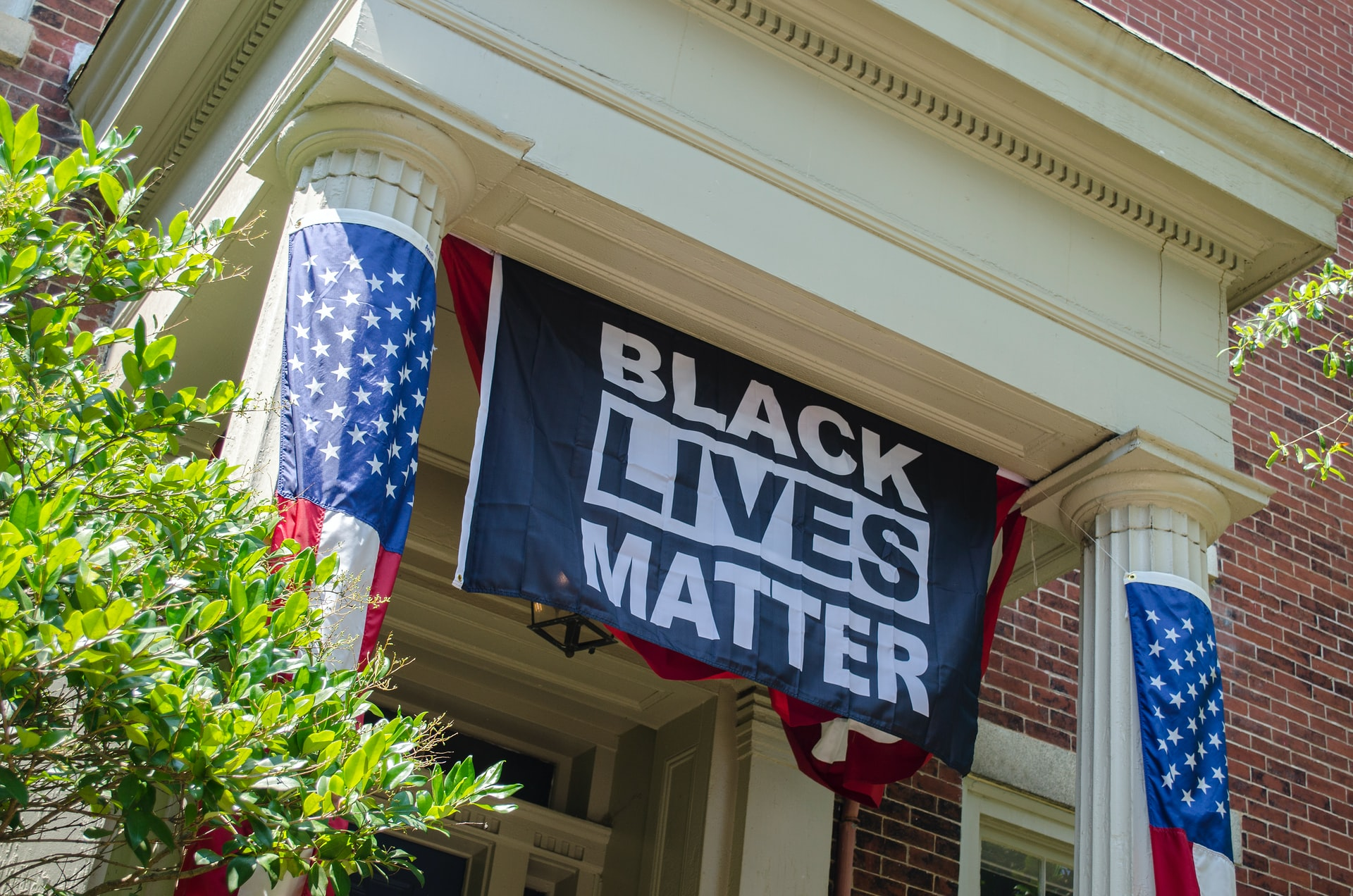 Photo of a Black Lives Matter flag against racism in the United States