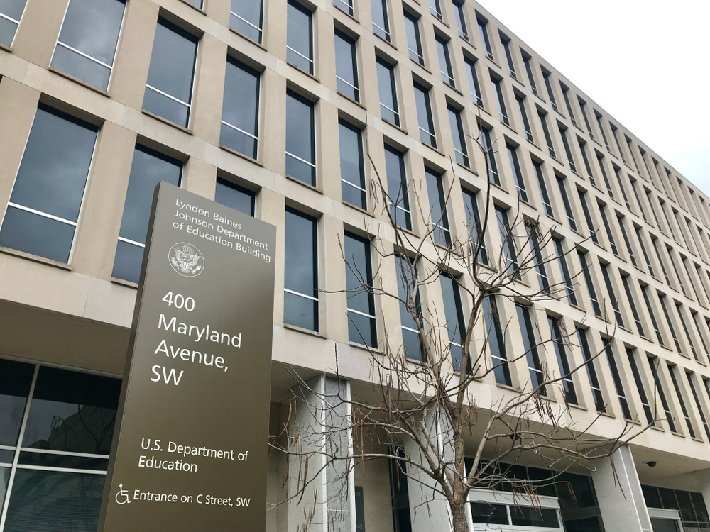 Department of Education headquarters building sign with building exterior