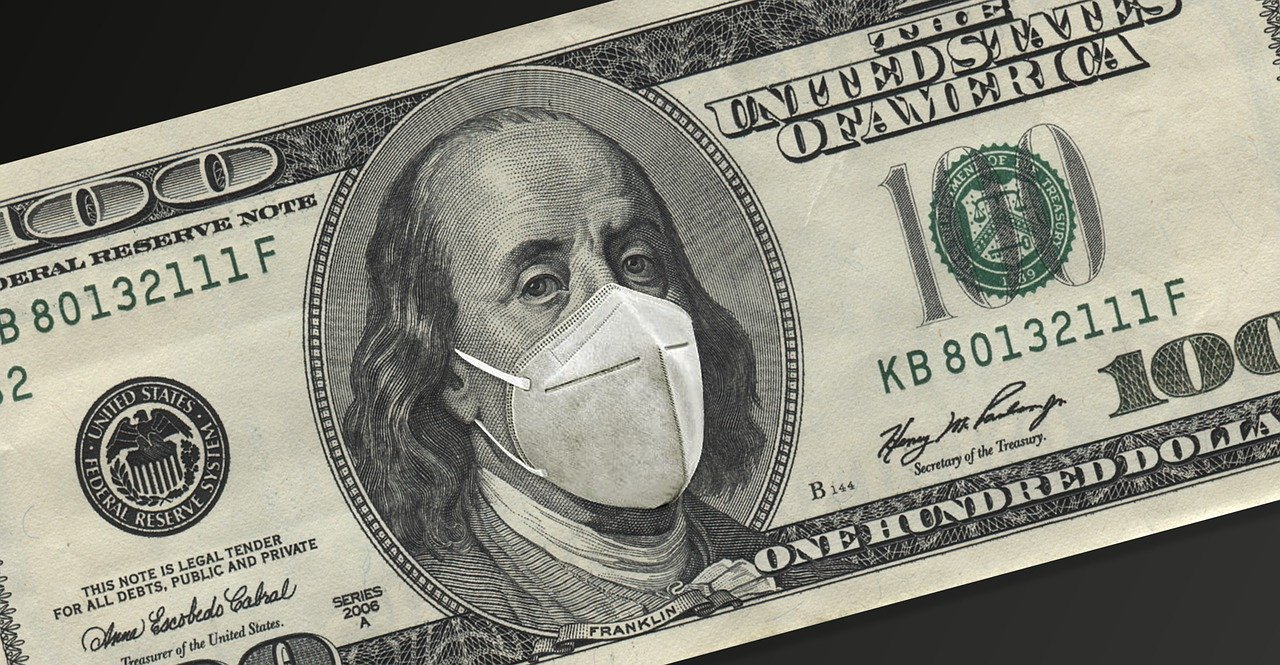 Photo of a dollar bill with a mask for COVID, relief package, stimulus benefits for college students