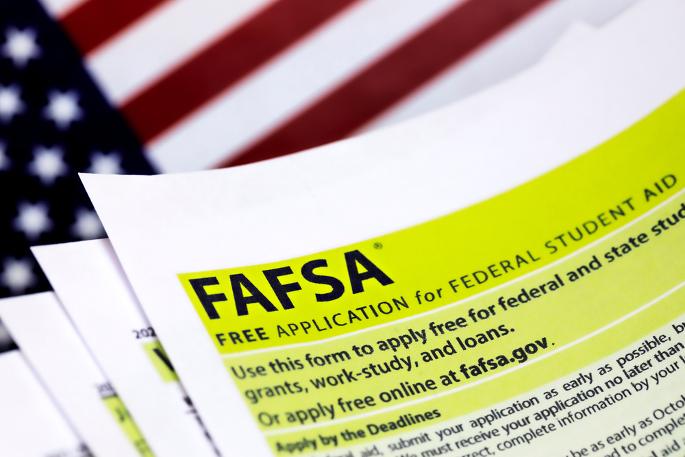 FAFSA federal student aid form on top of US flag