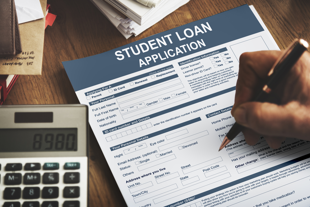 Student filling in student loan application form