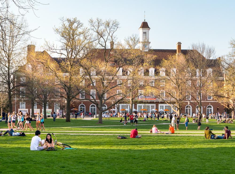 Students mingle on Quad lawn of University of Illinois college campus in Urbana Champaign