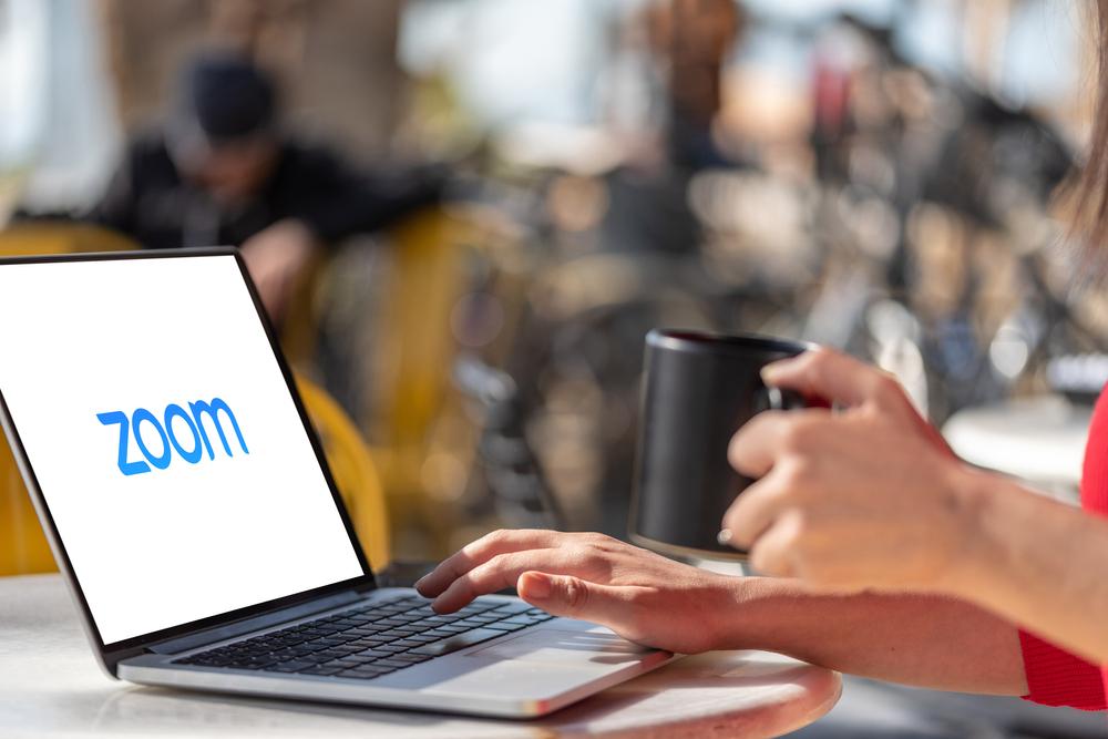 Laptop showing Zoom Cloud Meetings app logo