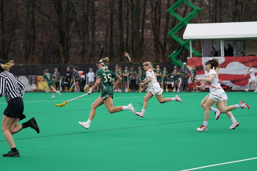 Female lacrosse players on the field