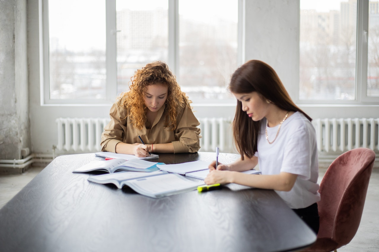 photo-of-two-girls-studying-with-cheap-college-textbooks