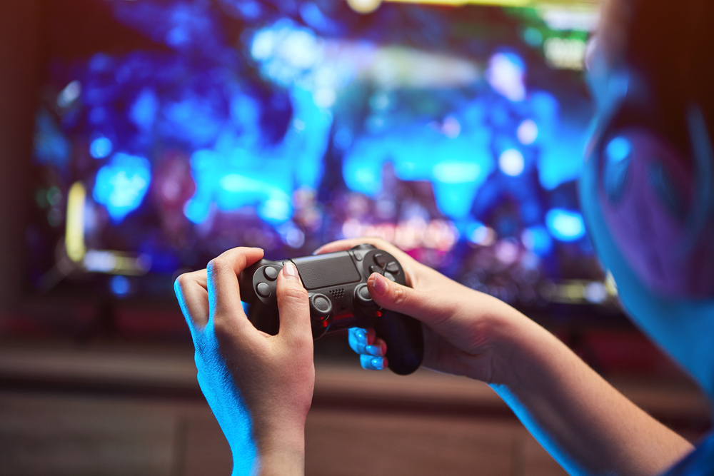 Close up of a gamer holding a videogame controller in hands