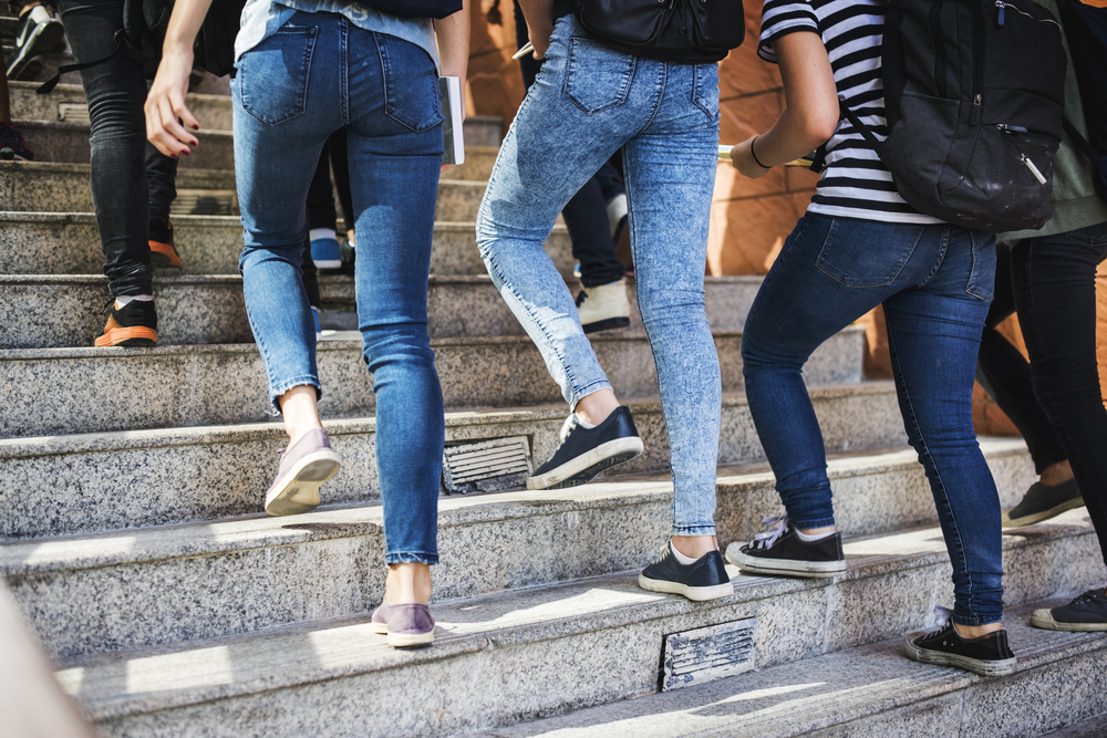 Group of students walking up the staircase at their university