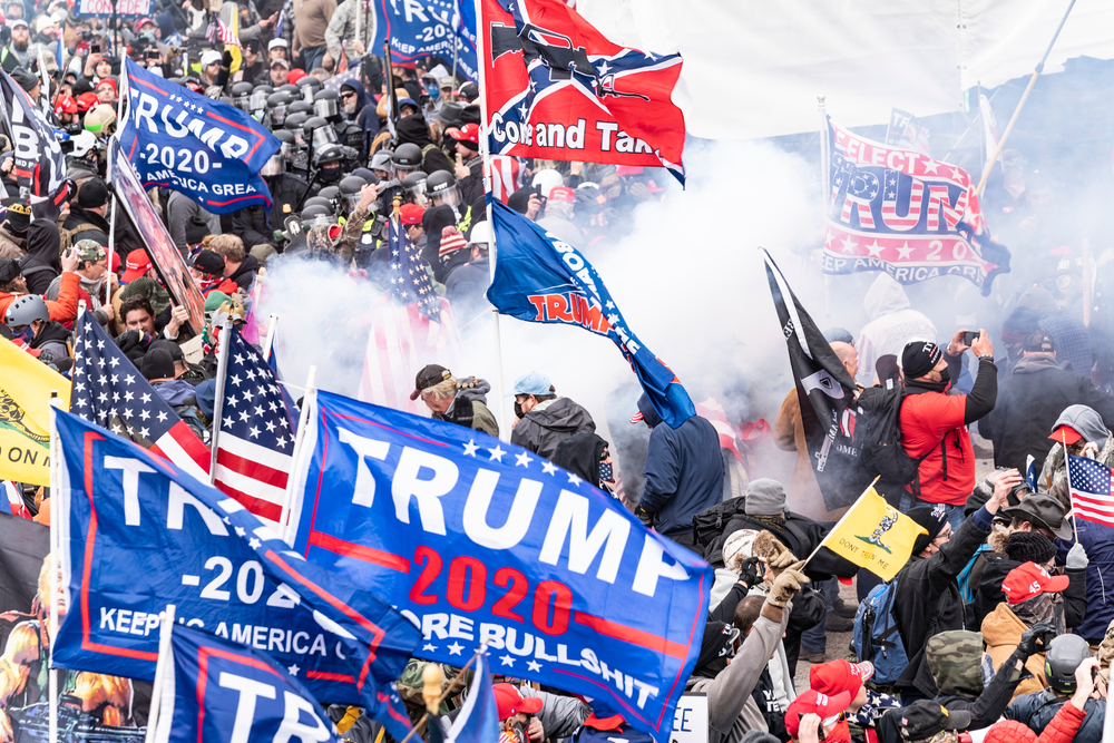 Smoke rises after explosure police used pepper-spray ball gun against Pro-Trump protesters rally around Capitol building before they breached it and overrun it
