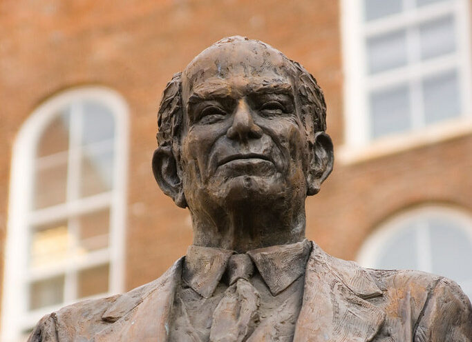 Statue of J. William Fulbright behind Old Main at the University of Arkansas