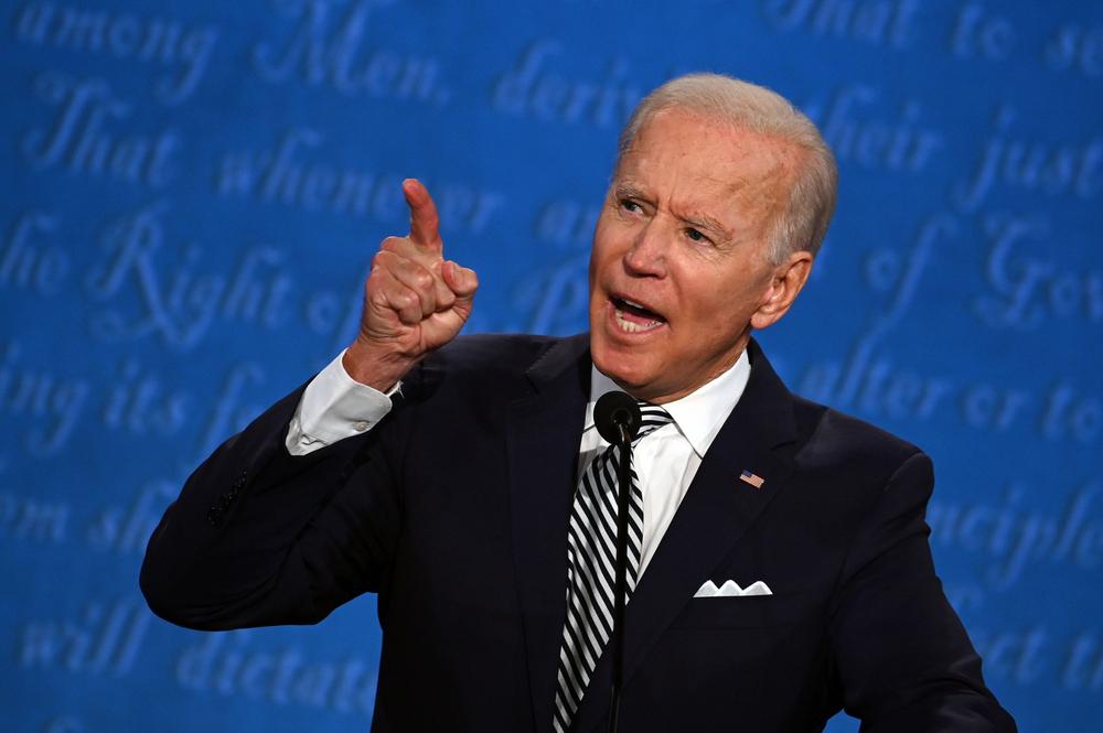 US President Joe Biden pointing while giving a speech