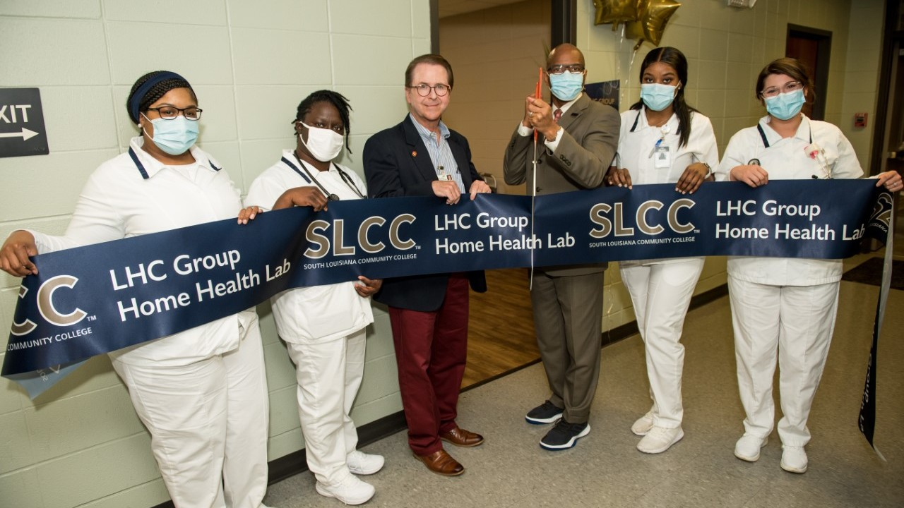 Students and administrators of South Louisiana Community College lead the opening of new Home Health Training Laboratory.