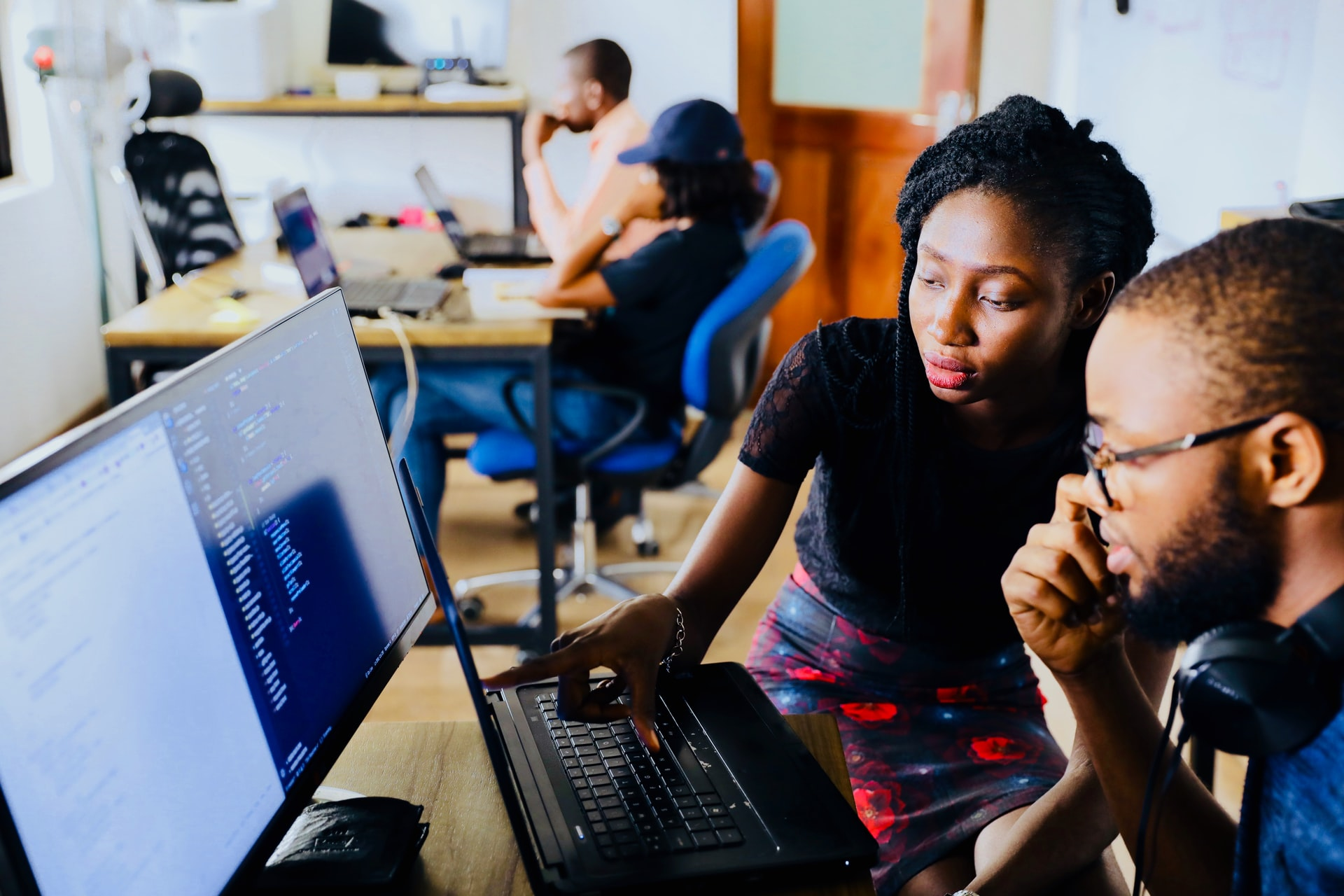 A teacher and a student in coding class.