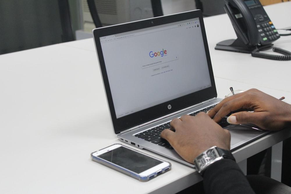 man using google in computer
